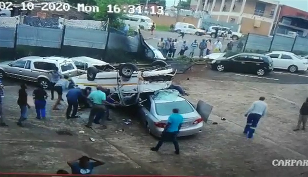 WATCH | Taxi crashes through wall in Durban, flipping and landing on its roof - News24