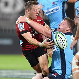 Brett Cameron of the Crusaders is tackled by Angus Bell of the Waratahs (Getty Images)