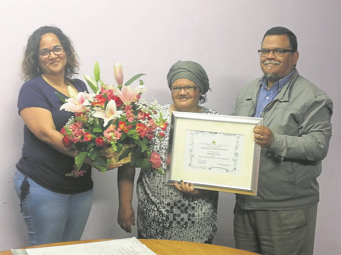 Moeridah Dien (centre) at her farewell as a police reservist, with Steenberg CPF's Beryl Cerff (left) and CPF chair, Gavin Walbrugh (right). PHOTO: Racine Edwardes
