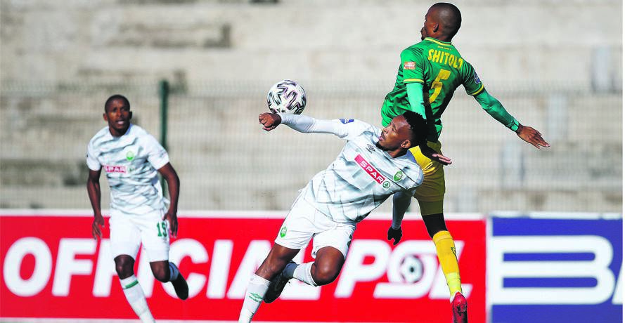 Lehlohonolo Majoro of AmaZulu and Gladwin Shitolo of Golden Arrows tussle for the ball during their DStv Premiership game at Sugar Ray Xulu Stadium in Clermont, Durban, yesterday. Usuthu claimed bragging rights with a 1-0 win. Photo: Charle Lombard /BackpagePix