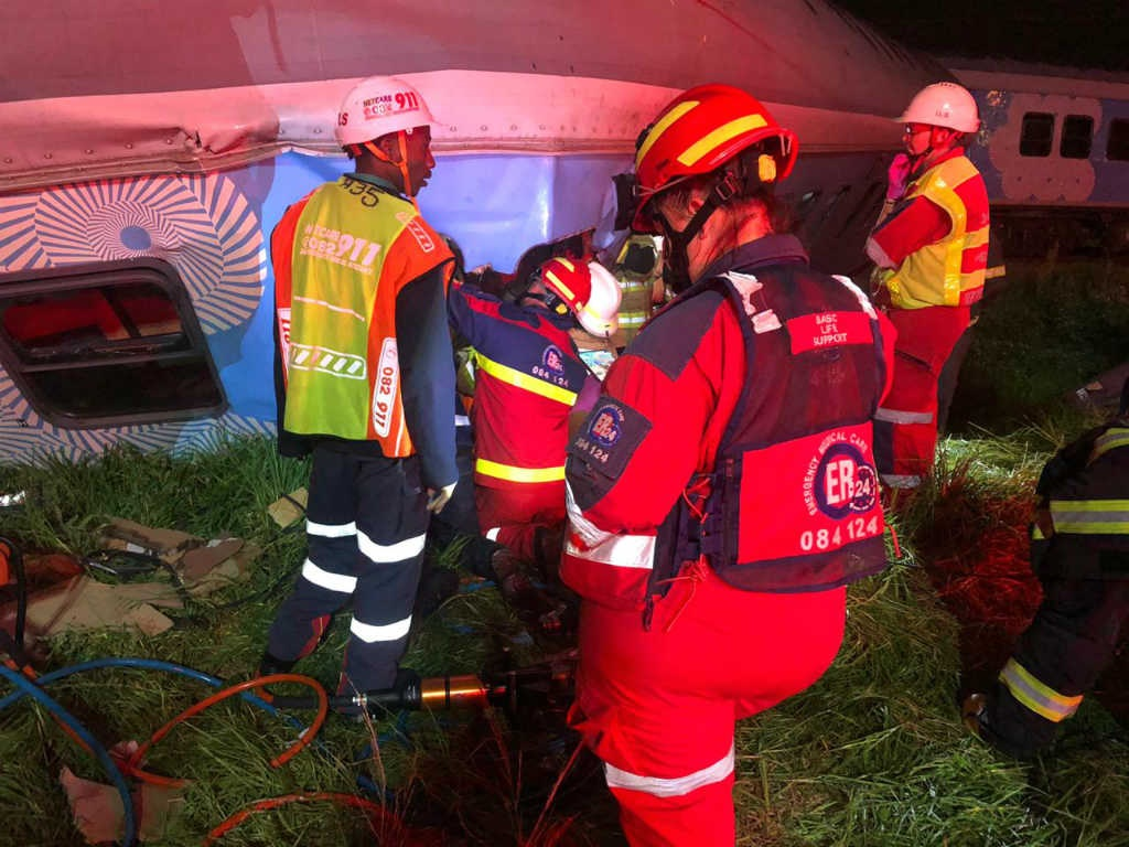 One man was killed and at least several other people were injured when a goods and passenger train collided on the tracks near Bonny Doone Road in Horizon View, west of Johannesburg. (Image via Twitter/@ER24EMS)