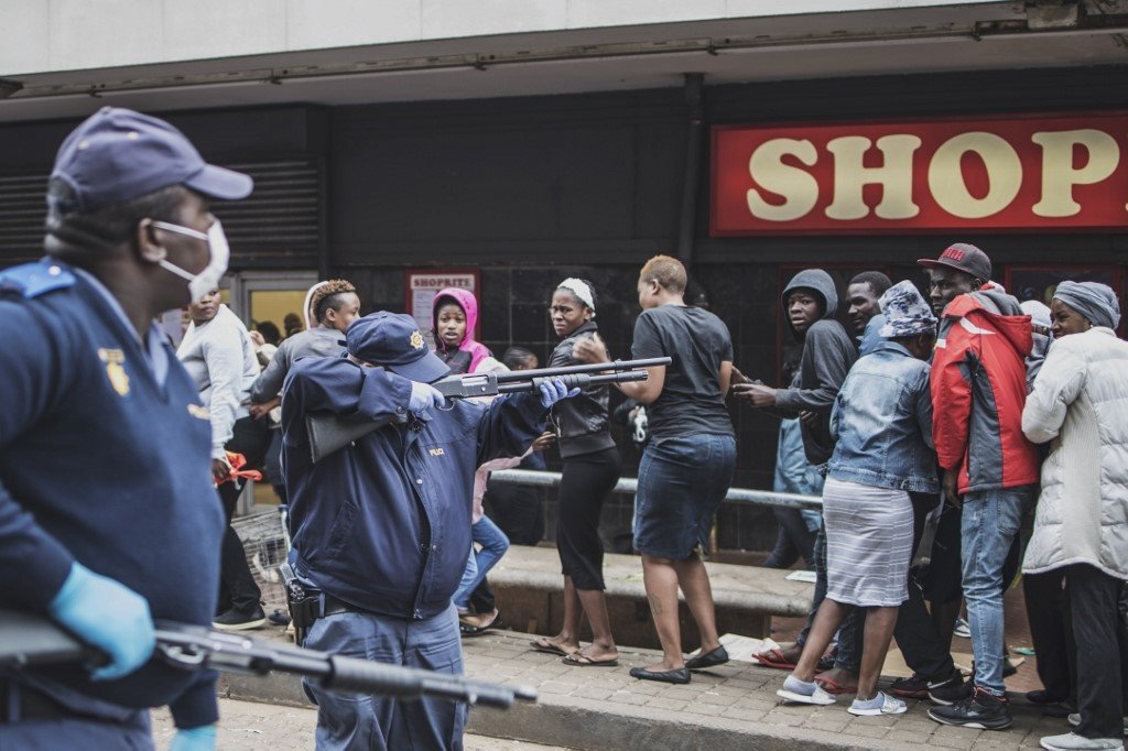 File: A South African policeman points his pump rifle to disperse a crowd of shoppers in Yeoville, Johannesburg. (Marco Longari, AFP)
