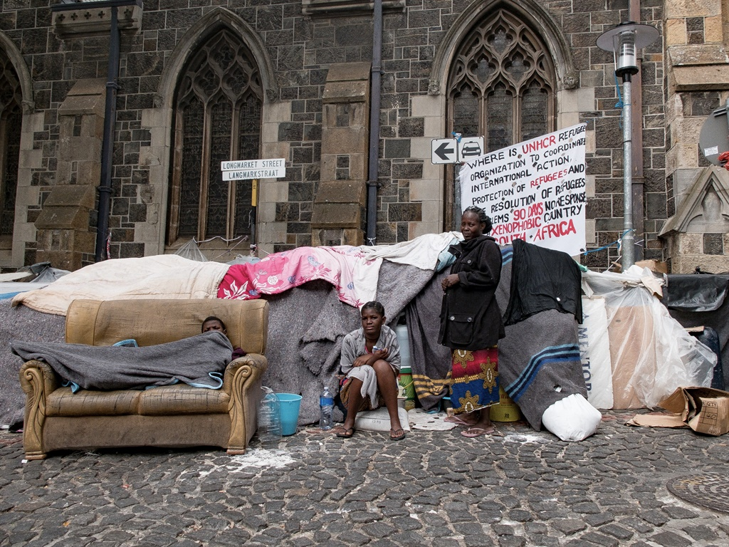 Refugees and asylum seekers living in squalor outside the Central Methodist Mission Church on Greenmarket Square in Cape Town. (Jan Gerber, News24)