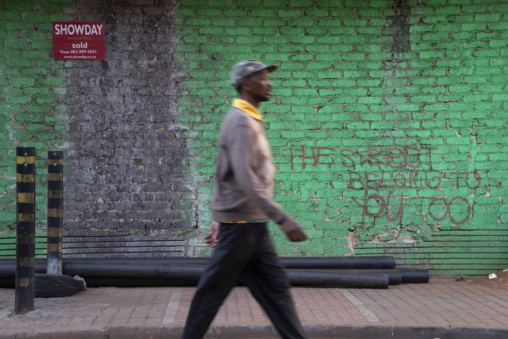 """""""The street belongs to you too."""" Maboneng is known for its trendy hipster joints, but outside its bubble, life goes on for the rest of the inner city's residents. (Photograph by James Oatway)"""