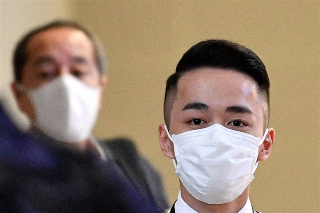People arriving from China  at OR Tambo International Airport cover up because of coronavirus.