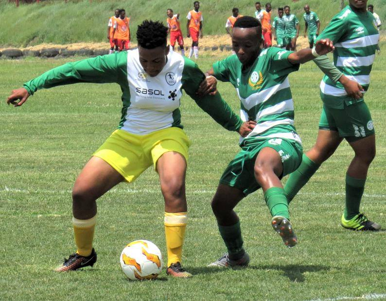Bloemfontein Celtic's Miss Sethunya (green) battles for the ball with Golden Ladies' Innocentia Gama during the South African Football Association National Women's League fixture played in Bloemfontein on Saturday (15/02). Celtic won by 3 - 2.Photo: Teboho Setena