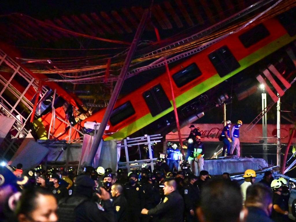 Rescue workers gather at the site of a metro train
