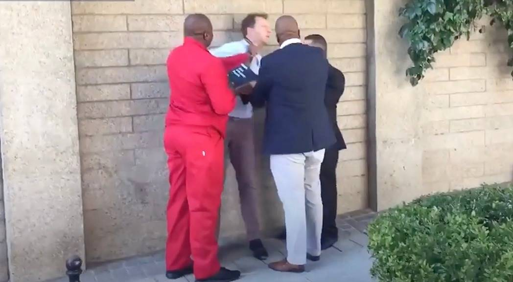 Floyd Shivambu seen in an altercation with Netwerk24 journalist Adrian de Kock outside Parliament.