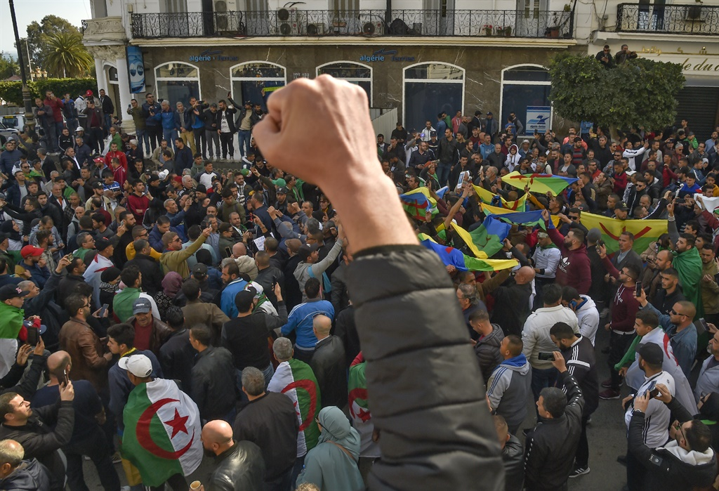 Algerian students raising Amazigh (Berber) and national flags shout slogans during their weekly anti-government demonstration in the capital Algiers. (AFP)