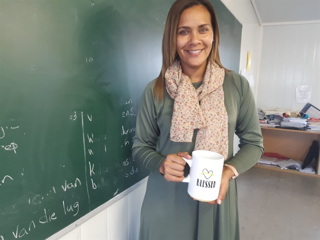 Founder Yumna Alexander with the mug in which part