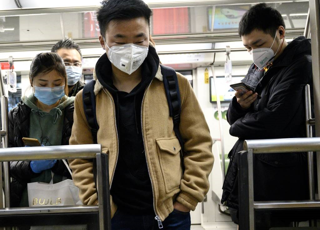 Passengers wearing protective face masks travel on the subway in Shanghai.