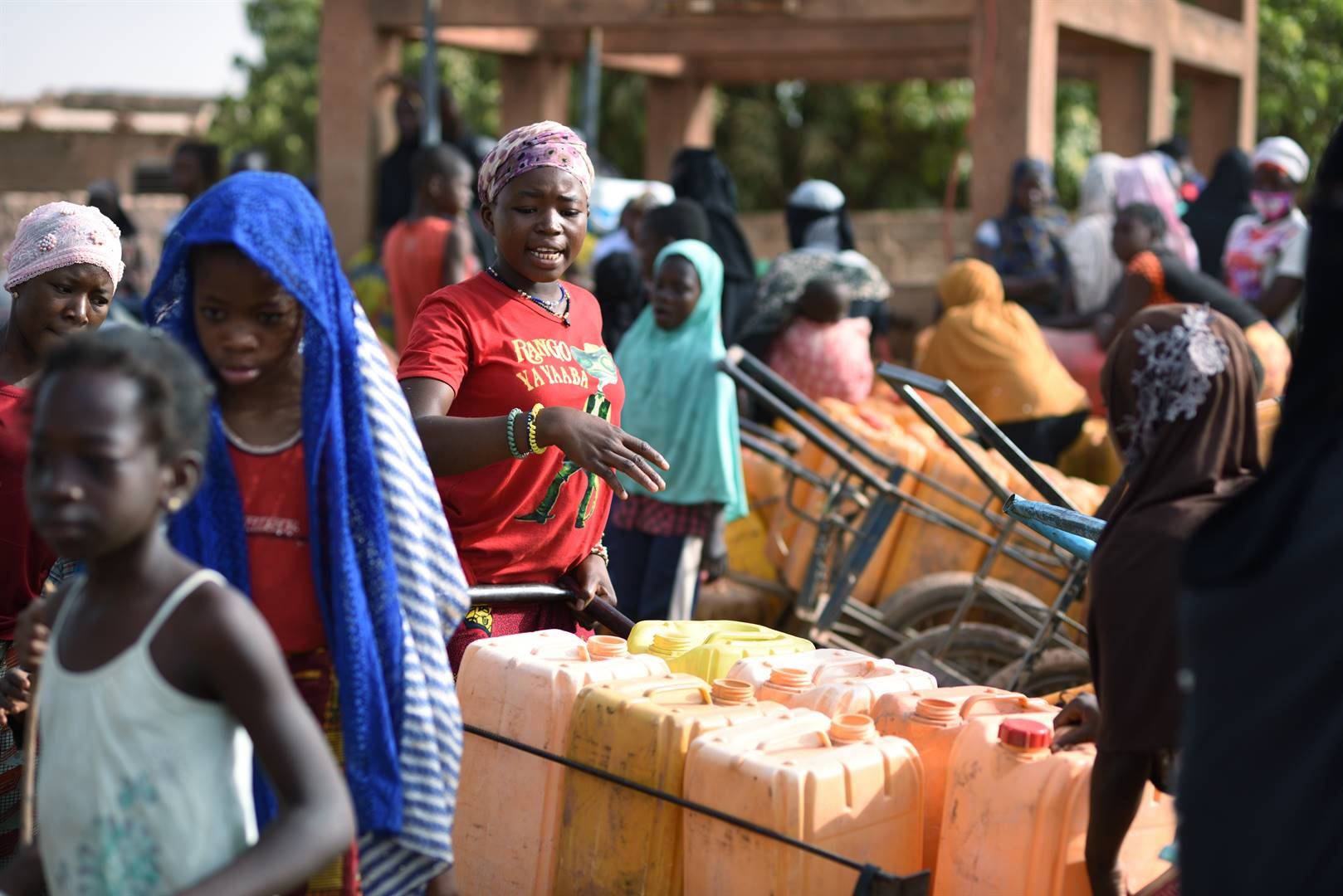 climate benefit People wait for their turn to buy water from a privately-owned water tower, amid an outbreak of the Covid-19 coronavirus pandemic, in Taabtenga district of Ouagadougou, Burkina Faso Photo: reuters