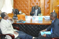 Peter Mirugi (left) and Michael Kingori (right) representing Sons and Daughters of freedom fighters (Mau Mau) talks with Nyeri county commissioner Michael Ole Tialal in his office. They wanted the commissioner to organize for them an appointment with President Uhuru Kenyata at State house Nairobi over some of the challenges they face. (Photo by Joseph Njung'eh)