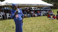 Othaya MP Mary Wambui addressing parents and pupils of Kaiguthu Primary school during a prize giving event. (Photo by Joseph Njung'eh)