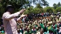 Ahadi Kenya director Stanley Kamau, addressing parents and pupils of Kairuthi Primary School. (Photo by Joseph Njung'eh)
