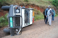 Traffic police officers at a scene where an ambulance overturned along Nyeri-Karatina road, while ferrying a patient from Isiolo to Kenyatta National Hospital (KNH). (Joseph Njung'eh, News24 user)