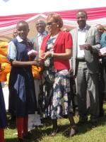 Nyeri governor Nderitu Gachagua's wife Margret Nderitu distributing sanitary towels to school girls at Gatuyaini Primary School in Othaya, Nyeri county.  (Joseph Njung'eh, News24 User)
