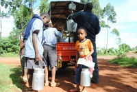Children delivers milk at a collection center in Mukurwe-ini Nyeri County where a litter of milk is going for as low as Sh30. Schools have been closed for December holiday and many pupils are busy helping their parents in domestic job.