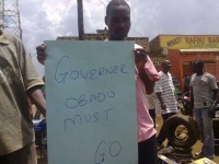 A demonstrator holding placard (Alfred Onyango, News24 user)