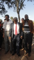 The National Alliance(TNA) Nyeri County Chairman (in red tie) with a group of his supporters at Central Police headquarters in Nyeri town. He was summoned by police following allegations that he insulted and threatened Kieni MP Kanini Kega. (Joseph Njung'eh, News24 User)