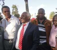Nyeri County TNA chairman Thuo Mathenge (in red tie). He appeared before investigative police officers in Nyeri town to record a statement on allegations that he insulted and threatened Kieni MP Kanini Kega. (Joseph Njung'eh, News24 User)