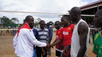 Kieni MP (left) welcoming volleyball players at Mweiga Wembley stadium during a tournament which he sponsored.