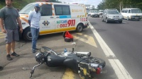 The motorcycle collided with a truck causing the rider to fall and land under the wheels of a three-ton truck.  (Chris Botha, Netcare911)